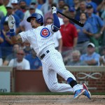 CHICAGO, IL - SEPTEMBER 02:  Javier Baez #9 of the Chicago Cubs falls to the ground after swinging and missing a pitch in the 9th inning against the Cincinnati Reds at Wrigley Field on September 2, 2015 in Chicago, Illinois. The Reds defeated the Cubs 7-4.  (Photo by Jonathan Daniel/Getty Images)