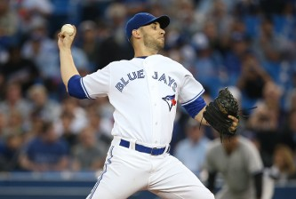 TORONTO, CANADA - SEPTEMBER 22: Marco Estrada #25 of the Toronto Blue Jays delivers a pitch in the first inning during MLB game action against the New York Yankees on September 22, 2015 at Rogers Centre in Toronto, Ontario, Canada. (Photo by Tom Szczerbowski/Getty Images)