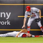 PITTSBURGH, PA - SEPTEMBER 28:  Stephen Piscotty #55 of the St Louis Cardinals lays on the ground while teammate Peter Bourjos #8 waits for the medical staff after colliding on a sliding catch from a ball hit by Josh Harrison #5 of the Pittsburgh Pirates in the 7th inning during the game at PNC Park on September 28, 2015 in Pittsburgh, Pennsylvania. Piscotty would be carted off of the field on a stretcher.  (Photo by Jared Wickerham/Getty Images)
