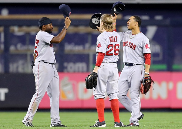 NEW YORK, NY - SEPTEMBER 29: Jackie Bradley Jr. #25,Brock Holt #26 and Mookie Betts #50 of the Boston Red Sox celebrate the win over the New York Yankees on September 29, 2015 at Yankee Stadium in the Bronx borough of New York City.The Boston Red Sox defeated the New York Yankees 10-4. (Photo by Elsa/Getty Images)