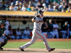 OAKLAND, CA - SEPTEMBER 26:  Jarrett Parker #47 of the San Francisco Giants hits a grand slam home run against the Oakland Athletics during the eighth inning at O.co Coliseum on September 26, 2015 in Oakland, California. The San Francisco Giants defeated the Oakland Athletics 14-10. (Photo by Jason O. Watson/Getty Images)