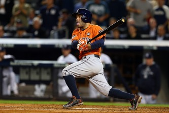NEW YORK, NY - OCTOBER 06:  Jose Altuve #27 of the Houston Astros hits a single in the second inning against Masahiro Tanaka #19 of the New York Yankees during the American League Wild Card Game at Yankee Stadium on October 6, 2015 in New York City.  (Photo by Elsa/Getty Images)