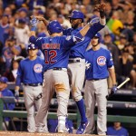 PITTSBURGH, PA - OCTOBER 07:  Kyle Schwarber #12 of the Chicago Cubs celebrates with Dexter Fowler #24 of the Chicago Cubs after hitting a two-run home run in the third inning during the National League Wild Card game between the Pittsburgh Pirates and the Chicago Cubs at PNC Park on October 7, 2015 in Pittsburgh, Pennsylvania.  (Photo by Justin K. Aller/Getty Images)