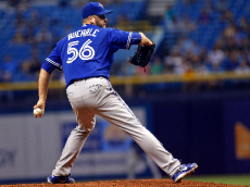 ST. PETERSBURG, FL - OCTOBER 2: Mark Buehrle #56 of the Toronto Blue Jays pitches during the second inning of a game against the Tampa Bay Rays on October 2, 2015 at Tropicana Field in St. Petersburg, Florida. (Photo by Brian Blanco/Getty Images)