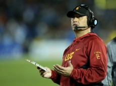 PASADENA, CA - NOVEMBER 22:  Head coach Steve Sarkisian of the USC Trojans gestures in the game against the UCLA Bruins at the Rose Bowl on November 22, 2014 in Pasadena, California.   UCLA on 38-20.  (Photo by Stephen Dunn/Getty Images)