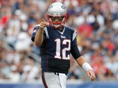 FOXBORO, MA - SEPTEMBER 21:  Tom Brady #12 of the New England Patriots gestures during the third quarter against the Oakland Raiders at Gillette Stadium on September 21, 2014 in Foxboro, Massachusetts.  (Photo by Jim Rogash/Getty Images)