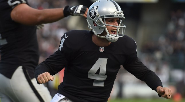 OAKLAND, CA - DECEMBER 21:  Derek Carr #4 of the Oakland Raiders celebrates a touchdown in the fourth quarter against the Buffalo Bills at O.co Coliseum on December 21, 2014 in Oakland, California.  (Photo by Thearon W. Henderson/Getty Images)