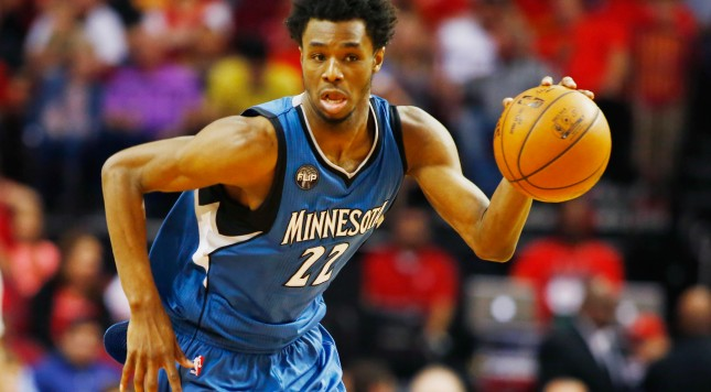 HOUSTON, TX - MARCH 18:  Andrew Wiggins #22 of the Minnesota Timberwolves takes the basketball up the court during their game against the Houston Rockets at the Toyota Center on March 18, 2016 in Houston, Texas.  NOTE TO USER: User expressly acknowledges and agrees that, by downloading and or using this Photograph, user is consenting to the terms and conditions of the Getty Images License Agreement.  (Photo by Scott Halleran/Getty Images)