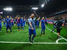NICE, FRANCE - JUNE 27:  Aron Gunnarsson (C) and Iceland players celebrate their team's 2-1 win with supporters after the UEFA EURO 2016 round of 16 match between England and Iceland at Allianz Riviera Stadium on June 27, 2016 in Nice, France.  (Photo by Dan Mullan/Getty Images)