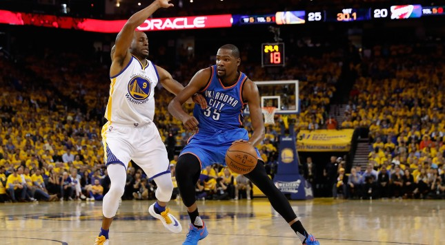 OAKLAND, CA - MAY 18:  Kevin Durant #35 of the Oklahoma City Thunder handles the ball against Andre Iguodala #9 of the Golden State Warriors during game two of the NBA Western Conference Finals at ORACLE Arena on May 18, 2016 in Oakland, California. TheWarriors defeated the Thunder 118-91. NOTE TO USER: User expressly acknowledges and agrees that, by downloading and or using this photograph, User is consenting to the terms and conditions of the Getty Images License Agreement.  (Photo by Christian Petersen/Getty Images)
