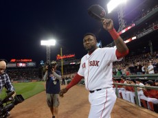 BOSTON, MA - SEPTEMBER 21: David Ortiz #34 of the Boston Red Sox walks out to acknowledge the crowd during a ceremony to honor his 500th home run hit last week in an away game at Fenway Park on September 21, 2015 in Boston, Massachusetts. (Photo by Darren McCollester/Getty Images)