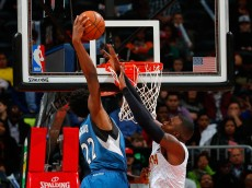 ATLANTA, GA - NOVEMBER 09:  Andrew Wiggins #22 of the Minnesota Timberwolves dunks on Paul Millsap #4 of the Atlanta Hawks at Philips Arena on November 9, 2015 in Atlanta, Georgia.  NOTE TO USER User expressly acknowledges and agrees that, by downloading and or using this photograph, user is consenting to the terms and conditions of the Getty Images License Agreement.  (Photo by Kevin C. Cox/Getty Images)