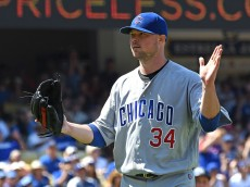 LOS ANGELES, CA - AUGUST 28: Jon Lester #34 of the Chicago Cubs claps his hands as he walks off the field after a double play ended the fourth inning against Los Angeles Dodgers at Dodger Stadium on August 28, 2016 in Los Angeles, California. (Photo by Jayne Kamin-Oncea/Getty Images)