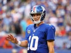 EAST RUTHERFORD, NJ - SEPTEMBER 18: Quarterback  Eli Manning #10 of the New York Giants reacts against the New Orleans Saints during the second half at MetLife Stadium on September 18, 2016 in East Rutherford, New Jersey.  (Photo by Al Bello/Getty Images)