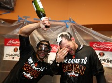 NEW YORK, NY - OCTOBER 05:  Conor Gillaspie #21 and Angel Pagan #16 of the San Francisco Giants celebrate their 3-0 victory over the New York Mets in the locker room after their National League Wild Card game at Citi Field on October 5, 2016 in New York City.  (Photo by Al Bello/Getty Images)