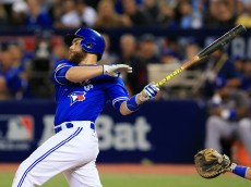 TORONTO, ON - OCTOBER 9: Russell Martin #55 of the Toronto Blue Jays drives in Josh Donaldson #20 (not pictured) to defeat the Texas Rangers 7-6 in the tenth inning during game three of the American League Division Series at Rogers Centre on October 9, 2016 in Toronto, Canada. (Photo by Vaughn Ridley/Getty Images)