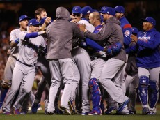 SAN FRANCISCO, CA - OCTOBER 11:  The Chicago Cubs celebrate after defeating the San Francisco Giants 6-5 in Game Four of their National League Division Series to advance to the National League Championship Series at AT&T Park on October 11, 2016 in San Francisco, California.  (Photo by Ezra Shaw/Getty Images)
