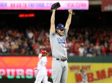 WASHINGTON, DC - OCTOBER 13: Clayton Kershaw #22 of the Los Angeles Dodgers celebrates after winning game five of the National League Division Series over the Washington Nationals 4-3 at Nationals Park on October 13, 2016 in Washington, DC. (Photo by Rob Carr/Getty Images)