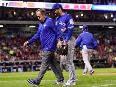 CLEVELAND, OH - OCTOBER 14:  Devon Travis #29 of the Toronto Blue Jays walks off the field after being injured in the fifth inning against the Cleveland Indians during game one of the American League Championship Series at Progressive Field on October 14, 2016 in Cleveland, Ohio.  (Photo by Jason Miller/Getty Images)
