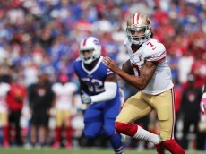 BUFFALO, NY - OCTOBER 16:   Colin Kaepernick #7 of the San Francisco 49ers runs the ball against the Buffalo Bills during the first half at New Era Field on October 16, 2016 in Buffalo, New York.  (Photo by Brett Carlsen/Getty Images)