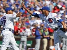 CHICAGO, IL - JULY 16: Addison Russell #27 (L) and Hector Rondon #56 of the Chicago Cubs celebrate a win over the Texas Rangers at Wrigley Field on July 16, 2016 in Chicago, Illinois. The Cubs defeated the Rangers 3-1. (Photo by Jonathan Daniel/Getty Images)