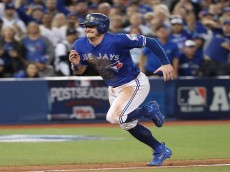 TORONTO, ON - OCTOBER 09: Josh Donaldson #20 of the Toronto Blue Jays races home to score the game-winning run in the tenth inning during MLB game action against the Texas Rangers in game three of the American League Divison Series at Rogers Centre on October 9, 2016 in Toronto, Canada. (Photo by Tom Szczerbowski/Getty Images)