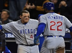 SAN FRANCISCO, CA - OCTOBER 11:  Jason Heyward #22 of the Chicago Cubs celebrates with Anthony Rizzo #44 after scoring the go ahead run on a RBI single by Javier Baez #9 in the eighth inning of Game Four of their National League Division Series against the San Francisco Giants at AT&T Park on October 11, 2016 in San Francisco, California.  (Photo by Thearon W. Henderson/Getty Images)