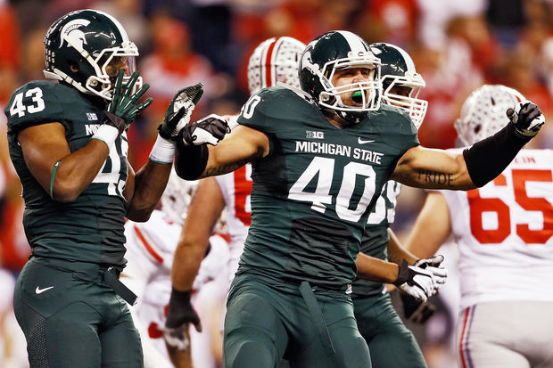 "Michigan State might very well have been the conference champion left out of a four-team playoff had the format existed last season. Either Michigan State or Stanford would have been on the outside of the candy store, and that concern about the value of conference championships is something that has to be kept firmly in mind during this debate. Even if you think strength of schedule is more important than a conference title for purposes of playoff selection, it's not as though the preference stems from a belief that conference titles mean little. It's more a belief that ""SOS"" has to matter to an even greater extent. Student Section associate editor Bart Doan makes the case in this roundtable that since ""SOS"" can be manipulated and inflated, the locked-in nature of a conference championship as a tangible achievement makes it a better criterion for playoff inclusion. That logic is unassailable. The point of emphasis in all this? Both SOS and conference titles need to be honored. The hard part is how the Selection Committee can manage to honor both as equally and evenly as possible."