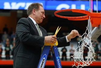 SYRACUSE, NY - MARCH 29:  Head coach Tom Izzo of the Michigan State Spartans celebrates by cutting down the net after defeating the Louisville Cardinals 76 to 70 in overtime of the East Regional Final of the 2015 NCAA Men's Basketball Tournament at Carrier Dome on March 29, 2015 in Syracuse, New York.  (Photo by Elsa/Getty Images)