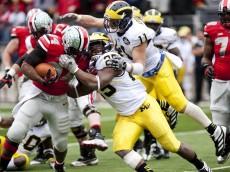 Michigan linebacker Kenny Demens and safety Jordan Kovacs tackle Ohio State running back Carlos Hyde on Saturday. Daniel Brenner I AnnArbor.com