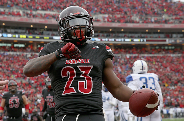 LOUISVILLE, KY - NOVEMBER 29:  Brandon Radcliff #23 of the Louisville Cardinals celebrates as he runs for a touchdown during the game against the Kentucky Wildcats at Papa John's Cardinal Stadium on November 29, 2014 in Louisville, Kentucky.  (Photo by Andy Lyons/Getty Images)