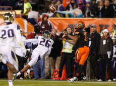 TEMPE, AZ - JANUARY 02:  Wide receiver Brandon Sheperd #7 of the Oklahoma State Cowboys catches a 47 yard touchdown reception against the Washington Huskies during the second quarter of the TicketCity Cactus Bowl at Sun Devil Stadium on January 2, 2015 in Tempe, Arizona.  (Photo by Christian Petersen/Getty Images)