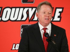 LOUISVILLE, KY - JANUARY 09:  Bobby Petrino talks to the media after being introduced as the head coach of the University of Louisville at Papa John's Cardinal Stadium on January 9, 2014 in Louisville, Kentucky.  (Photo by Andy Lyons/Getty Images)