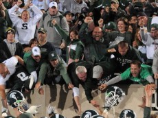 EAST LANSING, MI - SEPTEMBER 18:  The Michigan State Spartans fans celebrate the overtime victory against the Notre Dame Fighting Irish at Spartan Stadium on September 18, 2010 in East Lansing, Michigan. The Spartans defeated the Fighting Irish 34-31 in overtime.  (Photo by Mark Cunningham/Getty Images)