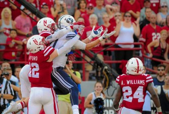 LINCOLN, NE - SEPTEMBER 5: Wide receiver Mitch Mathews #10 of the Brigham Young Cougars catches the game winning touchdown in front of linebacker Luke Gifford #12 and safety Nate Gerry #25 of the Nebraska Cornhuskers during their game at Memorial Stadium on September 5, 2015 in Lincoln, Nebraska. (Photo by Eric Francis/Getty Images)