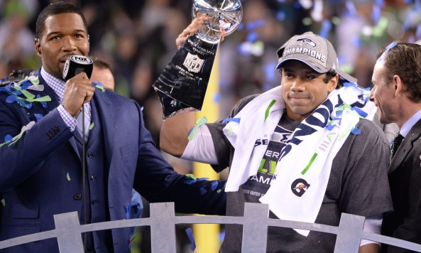 Russell Wilson Holds Lombardi Trophy Super Bowl XLVIII