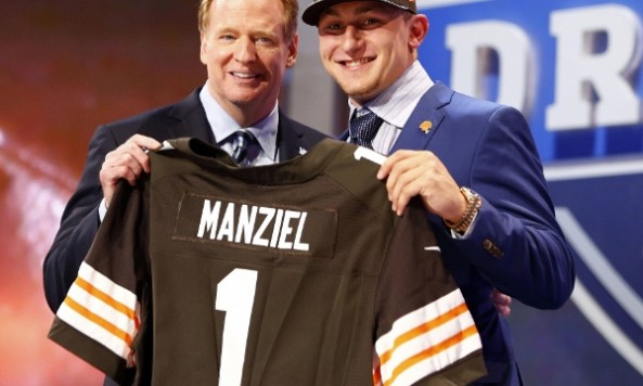 May 8, 2014; New York, NY, USA; Johnny Manziel (Texas A&M) poses for photos with commissioner Roger Goodell after being selected as the number twenty-two overall pick in the first round of the 2014 NFL Draft to the Cleveland Browns at Radio City Music Hall. Mandatory Credit: William Perlman/THE STAR-LEDGER via USA TODAY Sports