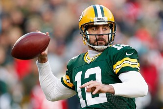 GREEN BAY, WI - NOVEMBER 30:  Quarterback Aaron Rodgers #12 of the Green Bay Packers throws a pass during the first quarter of the NFL game against the New England Patriots at Lambeau Field on November 30, 2014 in Green Bay, Wisconsin. The Packers defeated the Patriots 26-21.  (Photo by Christian Petersen/Getty Images)