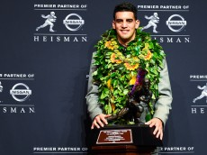 NEW YORK, NY - DECEMBER 13:  Oregon Ducks quarterback Marcus Mariota poses with the Heisman Trophy during a press conference after the 2014 Heisman Trophy presentation at the New York Marriott Marquis on December 13, 2014 in New York City.  (Photo by Alex Goodlett/Getty Images)