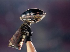 28 Jan 2001:  A general view of the Lombardi Trophy being held aloft before the Super Bowl XXXV Game between the New York Giants and Baltimore Ravens at the Raymond James Stadium in Tampa, Florida. The Ravens defeated the Giants 34-7.Mandatory Credit: Andy Lyons  /Allsport