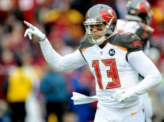 LANDOVER, MD - NOVEMBER 16:  Wide receiver Mike Evans #13 of the Tampa Bay Buccaneers celebrates after catching a third quarter touchdown against the Washington Redskins at FedExField on November 16, 2014 in Landover, Maryland.  (Photo by Mitchell Layton/Getty Images)