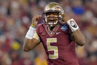 CHARLOTTE, NC - DECEMBER 06:  Jameis Winston #5 of the Florida State Seminoles calls an audible against the Georgia Tech Yellow Jackets during the Atlantic Coast Conference championship game on December 6, 2014 in Greenville, North Carolina. Florida State won 37-35.  (Photo by Grant Halverson/Getty Images)