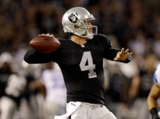 OAKLAND, CA - AUGUST 15:  Quarterback Derek Carr #4 of the Oakland Raiders passes the ball during their preseason game against the Detroit Lions at O.co Coliseum on August 15, 2014 in Oakland, California.  (Photo by Ezra Shaw/Getty Images)