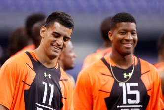 INDIANAPOLIS, IN - FEBRUARY 21: Quarterbacks Marcus Mariota of Oregon and Jameis Winston of Florida State look on during the 2015 NFL Scouting Combine at Lucas Oil Stadium on February 21, 2015 in Indianapolis, Indiana. (Photo by Joe Robbins/Getty Images)