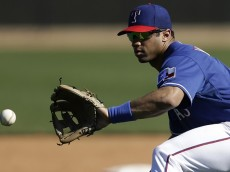 SURPRISE, AZ - MARCH 03: Russell Wilson #3 of the Texas Rangers runs through some infield drills during a work out before the game against the Cleveland Indians at Surprise Stadium on March 03, 2014 in Surprise, Arizona. (Photo by Mike McGinnis/Getty Images)