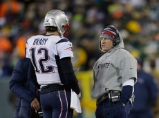 GREEN BAY, WI - NOVEMBER 30:  Quarterback Tom Brady #12 of the New England Patriots talks with head coach Bill Belichick in the second quarter during the NFL game against the Green Bay Packers at Lambeau Field on November 30, 2014 in Green Bay, Wisconsin.  (Photo by Mike McGinnis/Getty Images)