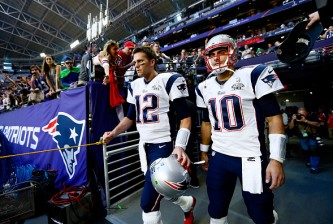 GLENDALE, AZ - FEBRUARY 01:  Tom Brady #12 and  Jimmy Garoppolo #10 of the New England Patriots walk to the field before Super Bowl XLIX against the Seattle Seahawks at University of Phoenix Stadium on February 1, 2015 in Glendale, Arizona.  (Photo by Kevin C. Cox/Getty Images)