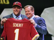 CHICAGO, IL - APRIL 30:  Brandon Scherff of the Iowa Hawkeyes holds up a jersey with NFL Commissioner Roger Goodell after being chosen #5 overall by the Washington Redskins during the first round of the 2015 NFL Draft at the Auditorium Theatre of Roosevelt University on April 30, 2015 in Chicago, Illinois.  (Photo by Jonathan Daniel/Getty Images)