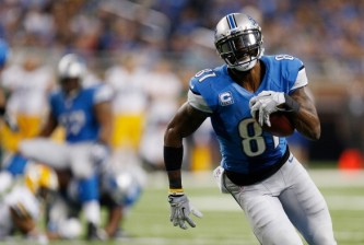 DETROIT, MI - NOVEMBER 28: Calvin Johnson #81 of the Detroit Lions runs for a third quarter touchdown while playing the Green Bay Packers at Ford Field on November 28, 2013 in Detroit, Michigan. (Photo by Gregory Shamus/Getty Images)