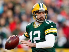 GREEN BAY, WI - NOVEMBER 30:  Quarterback Aaron Rodgers #12 of the Green Bay Packers dops back to pass during the NFL game against the New England Patriots at Lambeau Field on November 30, 2014 in Green Bay, Wisconsin. The Packers defeated the Patriots 26-21.  (Photo by Christian Petersen/Getty Images)